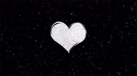 metafoor : White heart shape on black with noise. Seamless loop animation