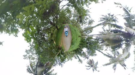 сферический : Riding a scooter in jungles of Koh Chang island, Thailand. Tiny little planet view
