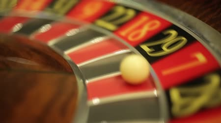 yirmi : Casino Roulette spinning and the ball stopping on red 7