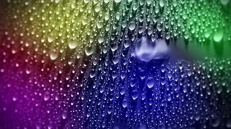 polychrome : A lot of water droplets on the surface. A large drop passes from right to left