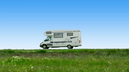 kamp : The camper leaves on road on a background of steppe grasses and the blue sky