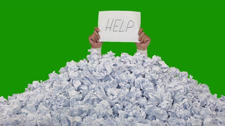 papelada : Green background (Chroma Key). New crumpled paper ball are added to the heap one by one. Mens hands in a white shirt lifted a sheet of paper with words. Includes matte for compositing over footage or abstract background