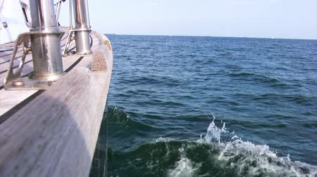 żaglówka : Sea. Sunny day. On the horizon, a few ships. Aboard a sailing yacht closeup. Slow motion Wideo
