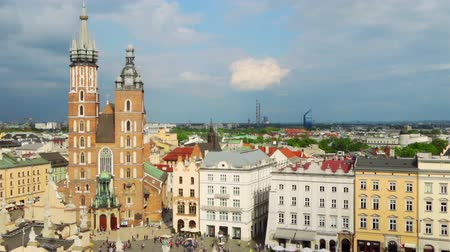 lengyelország : Poland. Krakow. Aerial view to Market square. A lot of people at the Church of St. Mary. Timelapse