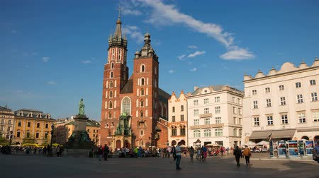 sukiennice : Poland. Krakow. People in the Market Square. Time lapse 4K. Editorial Use Only