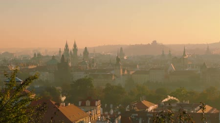 cseh : Czech Republic. Prague. Early cloudless morning over the roofs. Zoom out Stock mozgókép