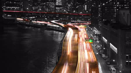 light trails : USA. New York City. Night traffic on the South street. Slow motion. Partial tinted in black and white