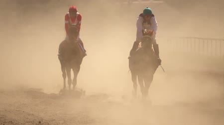 horse racing : Horse Racing at the Odessa hippodrome. Two Riders in the Dust. Super Slow motion