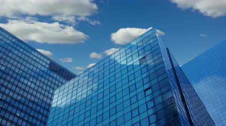Modern office skyscrapers. Blue sky and clouds. Time lapse UHD Стоковые видеозаписи