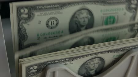 counter : Counting machine counts bills 2USD. Close up. Slow motion Stock Footage