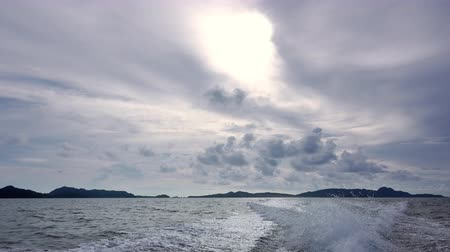 Open sea. The motor boat quickly sails away from the tropical islands. Beautiful clouds in the sky 動画素材