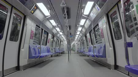 vasúti : Singapore. Subway train SMRT travels between stations. Empty car Stock mozgókép