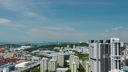 szingapúr : Singapore. Blue sky and clouds. Aerial view of the residential area and the seaport. Time lapse