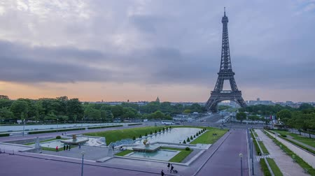 eifel : France. Paris. Morning. The Eiffel Tower and the Trocadero gardens. Colorful sky and fast clouds. Time lapse