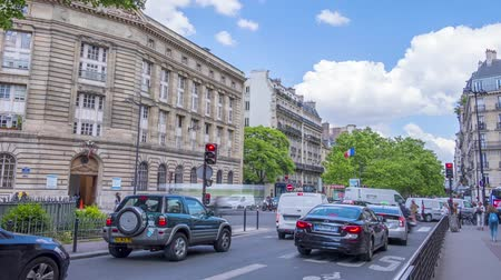 France, Paris. Sunny summer day. Plton traffic at the crossroads of two streets. Traffic lights. Clouds run fast. Time lapse