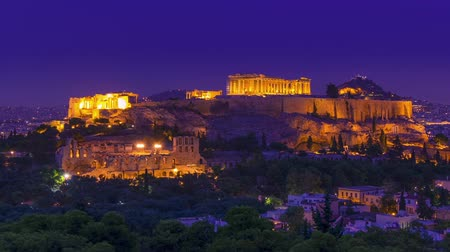 Greece. Athens. Parthenon. Pink sunset and the inclusion of night lights. Time lapse