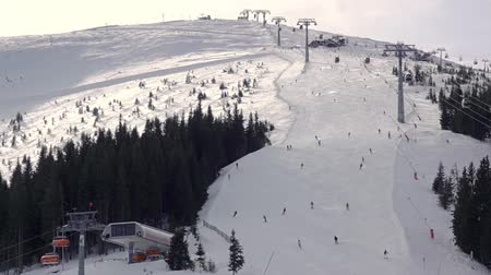 Ski resort. Many skiers descend the slope. Aerial view. Slow motion