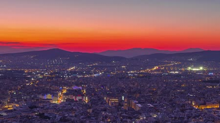 Greece. Panoramic view from a high point on Athens without the Acropolis. Colorful sunset. Time lapse Стоковые видеозаписи