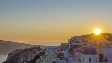 УВР : Greece. Thira Island Roofs of Oia during a colorful sunset. Time lapse