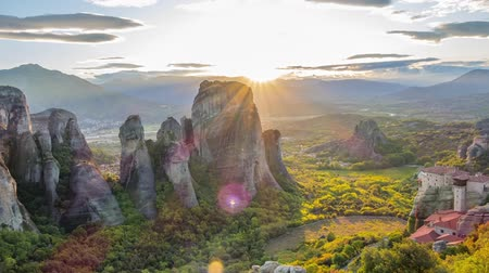 Greece. Meteora Monasteries on the rocks, listed by UNESCO. Summer sunset. Time lapse