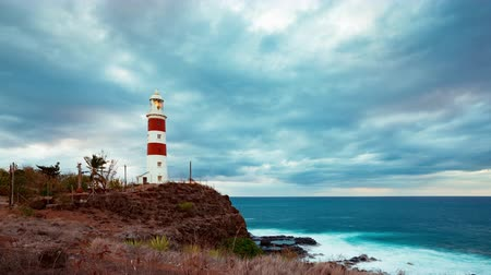 Clouds over lighthouse on rocky tropical island timelapse. Pointe aux Caves also known as Albion lighthouse. Mauritius