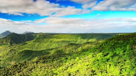 Cloud shadows over tropical rainforest covered hills timelapse. Black River Gorges National Park, Mauritius. 影像素材