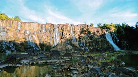 Waterfall in the jungles panorama view slow motion. Pongour waterfall in central highlands of Vietnam.