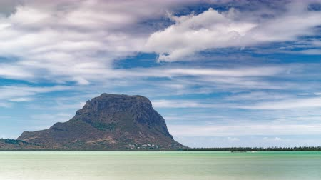 Paradise rocky tropical island day time lapse. Clouds over the Le Morne Brabant at day time. Mauritius.