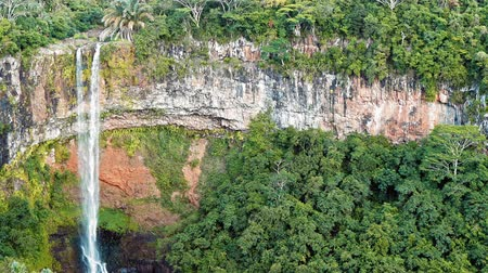 Waterfall in the jungles panorama view slow motion. Scenic Chamarel waterfall. Mauritius island 影像素材