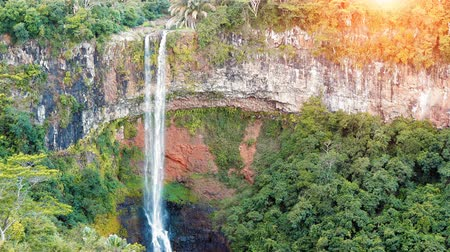 Waterfall in the jungles panorama view slow motion. Scenic Chamarel waterfall. Mauritius island. 影像素材