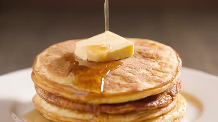 sirup : classic pancakes with butter and maple syrup, hd footage