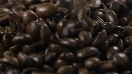 rosto : dark roasted coffee beans for espresso falling in slow motion