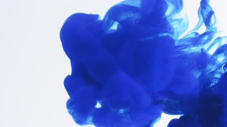 blue ink spreading in water
