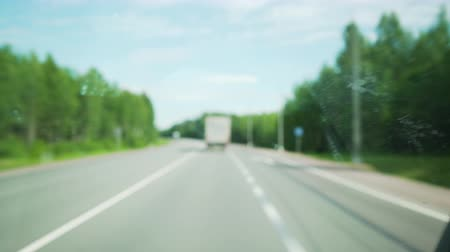ponto de referência : blurred background of fast ride on highway shot through dirty windscreen