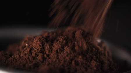 coffee grounds : freshly ground coffee pours into the filter in 180fps slow motion