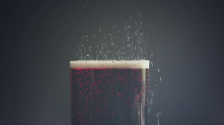 навес : cola in the glass over dark background with bubbles in slow motion Стоковые видеозаписи