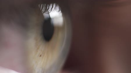 close up shot : super macro shot of female teen green eye in slow motion Stock Footage