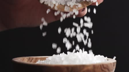 common salt : coarse sea salt crystal falling from one bowl to another in slow motion Stock Footage