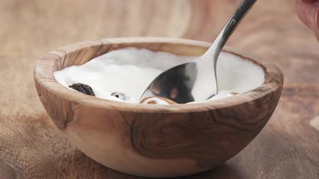 wallnut : eat nuts and fruits mix with yougurt cream in bowl on table in slow motion Stock Footage