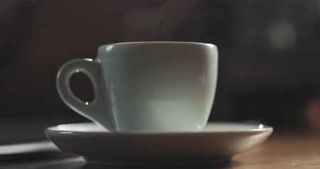 caffe : steam rising from espresso cup with fresh hot coffee in slow motion, 4k