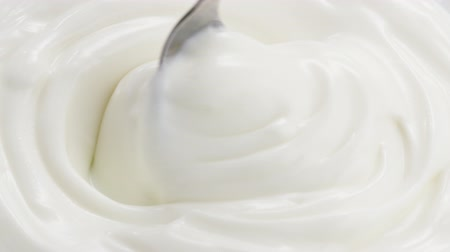 Slow motion of mixing yogurt with spoon, 180fps