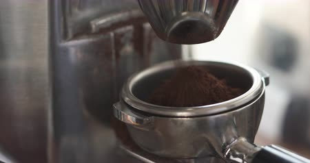 portafilter : ground coffee falling from grinder to portafilter for preparing espresso sequence of 2 shots, 4k