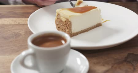 spoons : Slow motion of teenage girl eating cheesecake with caramel and drink coffee, 4k Stock Footage