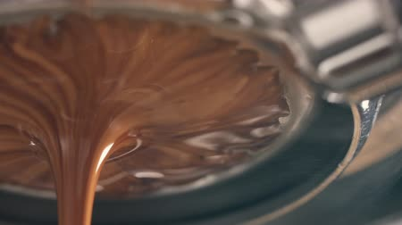black coffee : toned coffee extraction with bottomless portafilter on professional espresso machine Stock Footage
