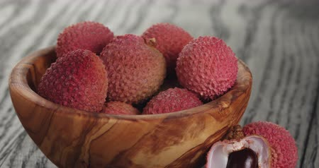 lychees : ripe lychees in wood bowl