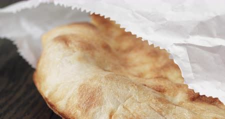 italian speciality : close up of freshly baked flat pita bread Stock Footage