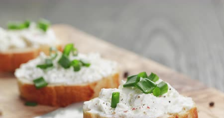 crostini : homemade appetizing crostini with soft cheefe cream and onion chives Stock Footage