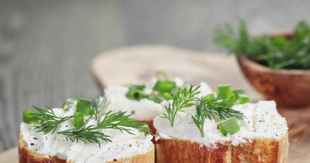crostini : homemade appetizing crostini with soft cheese cream herbs Stock Footage