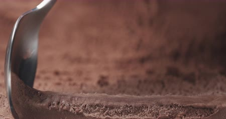совок : Slow motion of scooping chocolate ice cream with spoon