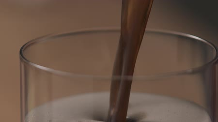 craft beer : Slow motion pour dark beer in glass Stock Footage